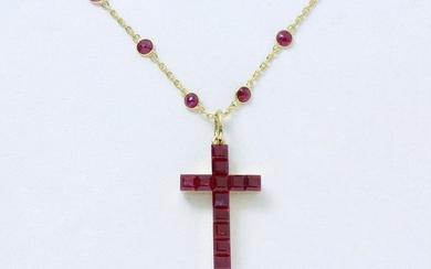 Pendant in 750 thousandths gold holding a cross...