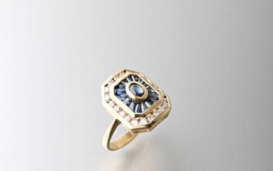 Ring in 750 thousandths yellow gold, oval sapphires and baguette ring surrounded by a row of small diamonds