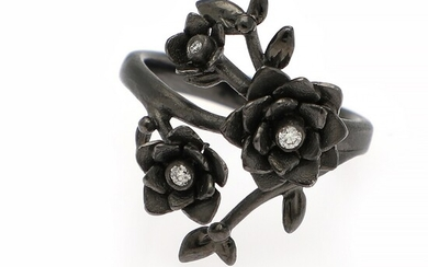 Ruben Svart: A diamond ring set with three brilliant-cut diamonds weighing a total of app. 0.06 ct., mounted in 14k black rhodium plated white gold.