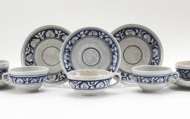 """SEVEN DEDHAM POTTERY CUPS AND NINE SAUCERS In Rabbit pattern. Saucer diameters 6.25""""."""