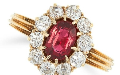 SPINEL AND DIAMOND CLUSTER RING set with an oval cut