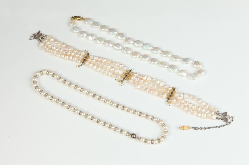 THREE ASSORTED PEARL CHOKERS. One cultured pearl with rhinestone roundels;...