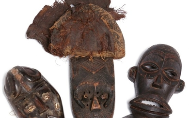 Three masks of carved patinated wood. Chokwe, Dan and D. R. Congo style. H. 30–35 cm. (3)