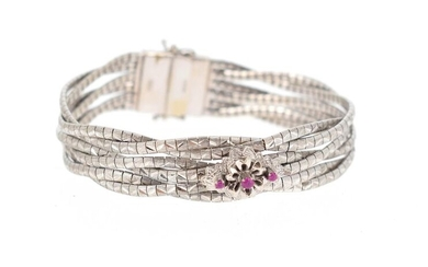 18 K (750 °/°°°) white gold bracelet composed of a six-row guilloché and braided mesh, the centre set with small treated rubies.