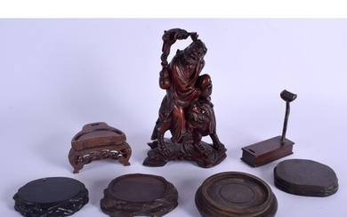 A 19TH CENTURY CHINESE CARVED HARDWOOD FIGURE OF AN IMMORTAL...