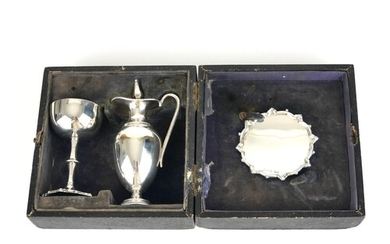 A CASED VICTORIAN SILVER COMMUNION SET Having a miniature ew...