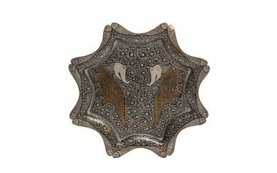 A COPPER AND SILVER-INLAID DISH India, late 19th - early 20th century