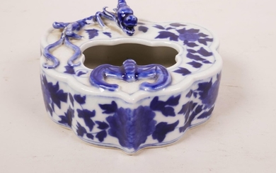 A Chinese blue and white porcelain ink pot with applied drag...