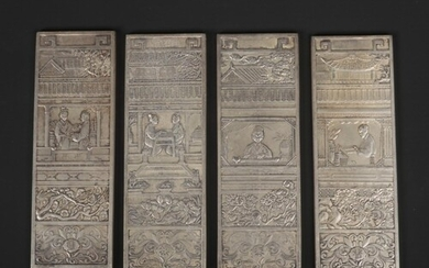 A Chinese white metal miniature four panel screen. Decorated...