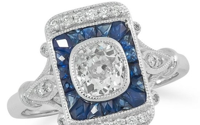 A DIAMOND AND SAPPHIRE DRESS RING set with a central