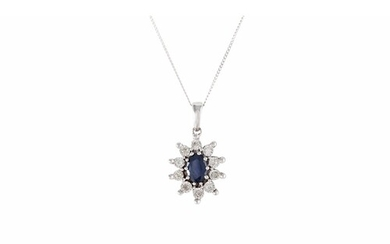 A DIAMOND AND SAPPHIRE PENDANT, mounted in white gold, on a ...