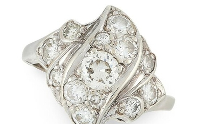 A DIAMOND CLUSTER DRESS RING designed with scrolling