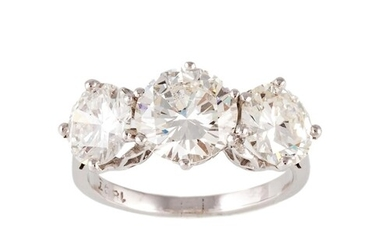A DIAMOND THREE STONE RING, the brilliant cut diamonds mount...