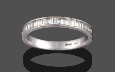 A Platinum Diamond Half Hoop Ring, the baguette cut diamonds...