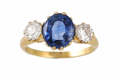 A SAPPHIRE AND DIAMOND THREE STONE RING, one oval cut sapphi...