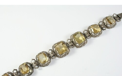 A VICTORIAN CITRINE AND SILVER BRACELET formed with graduate...