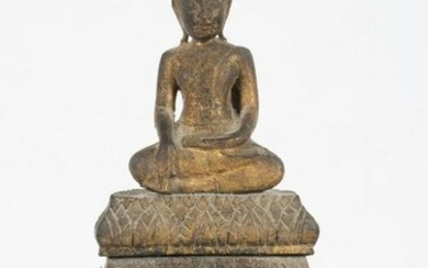 A figure of Buddha, Chien Saen style, in carved and