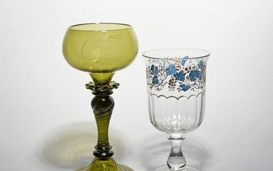 A large green glass ceremonial goblet dated 1882, the shallow rounded bowl engraved with the initials CF, the reverse with '5/1 1882', raised on a spiral moulded inverted baluster stem above a tall conical foot, and a Continental glass celery vase...