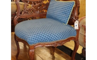 A late 19th century French carved walnut corner chair, W.44c...