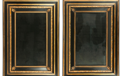 A pair of large ebonised and parcel gilt Continental mirrors, 20th century