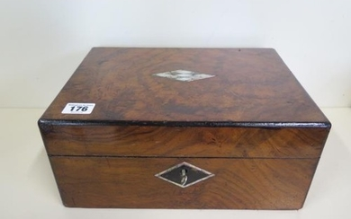 A sewing box with mother of pearl inlay fitted interior with...