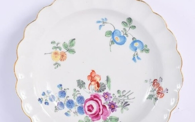 AN 18TH CENTURY WORCESTER SCALLOPED PLATE painted with