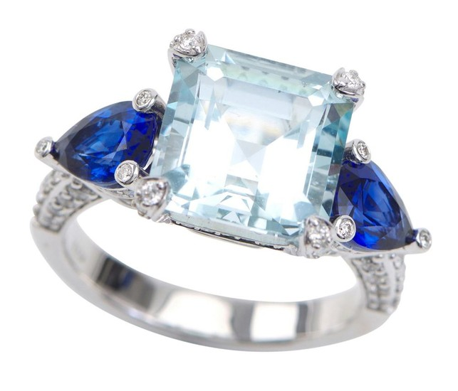 AN AQUAMARINE, SAPPHIRE AND DIAMOND RING - Featuring a square emerald cut aquamarine weighing 6.38cts, flanked by trilliant cut sapp...