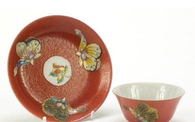 Chinese red ground porcelain tea bowl and saucer hand painte...