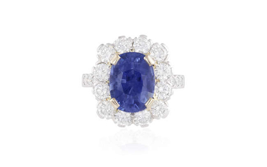 Description A SAPPHIRE AND DIAMOND CLUSTER RING The oval-shaped...