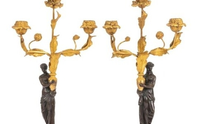 Pair of small Louis XVI style candelabra in chased, patinated and gilded bronze and white alabaster in the form of a figure draped in antique style carrying a vase from which three light arms in the form of a peony branch escape