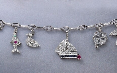 Platinum charm bracelet with diamonds , different...