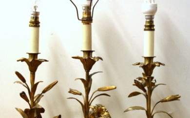 Three French gilt bronze floral candle sticks mounted as table lamps, with silk shades, H. 70cm.