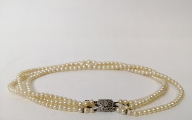 Three strand cultured pearl necklace, on French white gold s...