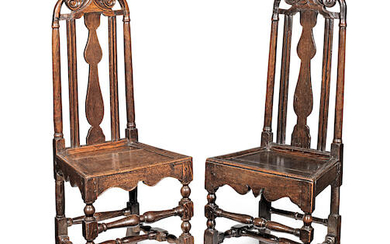 Two similar and unusual early 18th century oak high-back chairs, English, circa 1710-20