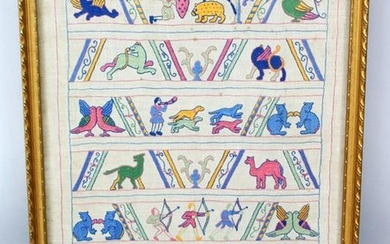 A 20TH CENTURY INDIAN FRAMED EMBROIDERED FABRIC
