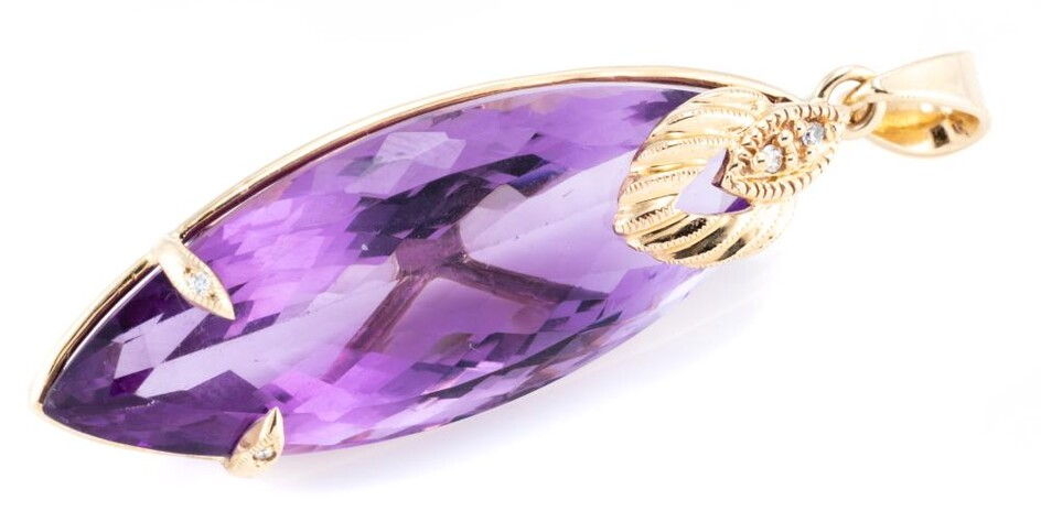 A 9CT GOLD AMETHYST AND DIAMOND PENDANT; featuring a long navette cut amethyst of approx. 26ct, with 2 claws and surmount set with 4...