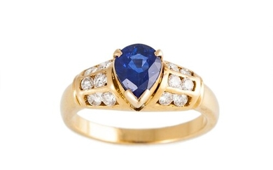 A DIAMOND AND SAPPHIRE RING, the pear shaped sapphire to cha...