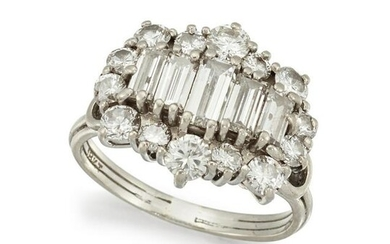 A DIAMOND DRESS RING Centred by a graduated row of
