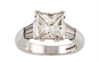 A DIAMOND SOLITAIRE RING mounted in platinum, with princess ...