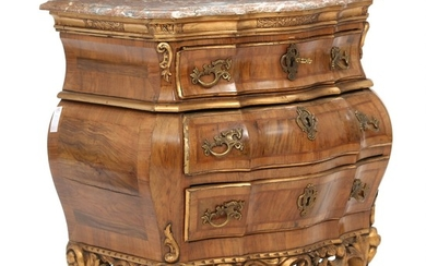 A Danish Rococo style walnut and giltwood commode with marble top. Early 20th century. H. 74 cm. W. 71 cm. D. 50 cm.