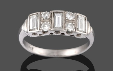 A Diamond Ring, three baguette cut diamonds in white rubbed...