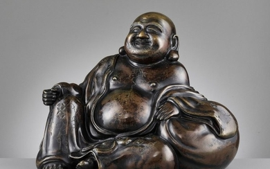 A LARGE AND HEAVILY CAST BRONZE FIGURE OF...