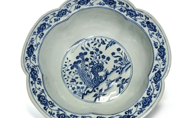 A LARGE CHINESE BLUE AND WHITE FLOWER SHAPED BOWL