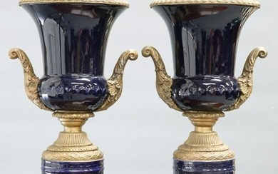 A LARGE PAIR OF GILT-METAL MOUNTED BLUE-GLAZED URNS
