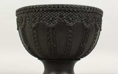 A LARGE WEDGWOOD BLACK BASALT CIRCULAR FRUIT BOWL, the