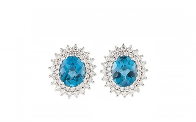 A PAIR OF DIAMOND AND TOPAZ CLUSTER EARRINGS, the oval stone...