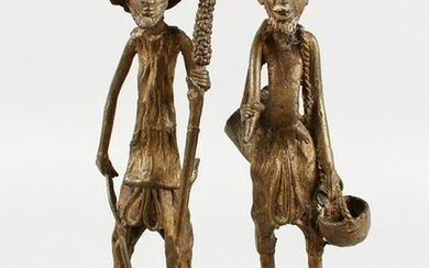 A PAIR OF NATIVE BRONZE LONG FIGURES. 12ins high.