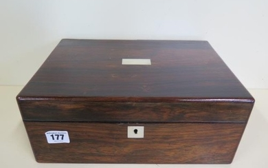 A Rosewood sewing box fitted interior with contents