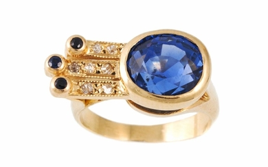 A SAPPHIRE AND DIAMOND RING, the oval cut sapphire estimated...