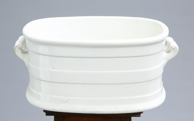 A VICTORIAN WHITE-GLAZED POTTERY FOOTBATH, with twin